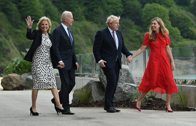 Britain's Prime Minister Boris Johnson (2R) and his wife Carrie Johnson (R) walk with US President Joe Biden and US First Lady Jill Biden, prior to a bi-lateral meeting, at Carbis Bay, Cornwall on June 10, 2021, ahead of the three-day G7 summit being held from 11-13 June.  G7 leaders from Canada, France, Germany, Italy, Japan, the UK and the United States meet this weekend for the first time in nearly two years, for the three-day talks in Carbis Bay, Cornwall. -   / AFP / Brendan SMIALOWSKI