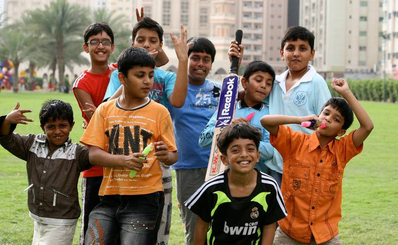 SHARJAH, UNITED ARAB EMIRATES Ð April 18: Children posing for the photo at Abu Shagara park in Sharjah. (Pawan Singh / The National) For House&Home For House & Home Neighbourhood column. Abu Shingara /Abu Shagara *** Local Caption ***  PS17- ABU SHAGARA.jpg
