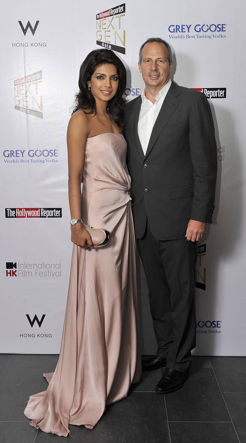 HONG KONG - MARCH 24:  Hollywood Reporter's Senior VP, Publishing Director Eric Mika (R) and Indian actress and former Miss World Priyanka Chopra attend The Hollywood Reporter Next Gen Asia Launch Cocktail Reception event at the W Hotel Kowloon on March 24, 2009 in Hong Kong, China.  The initiative has recognised over 500 individuals under 35 over the last 15 years, and is run in conjunction with the Hong Kong International Film Festival.  (Photo by Victor Fraile/Getty Images)