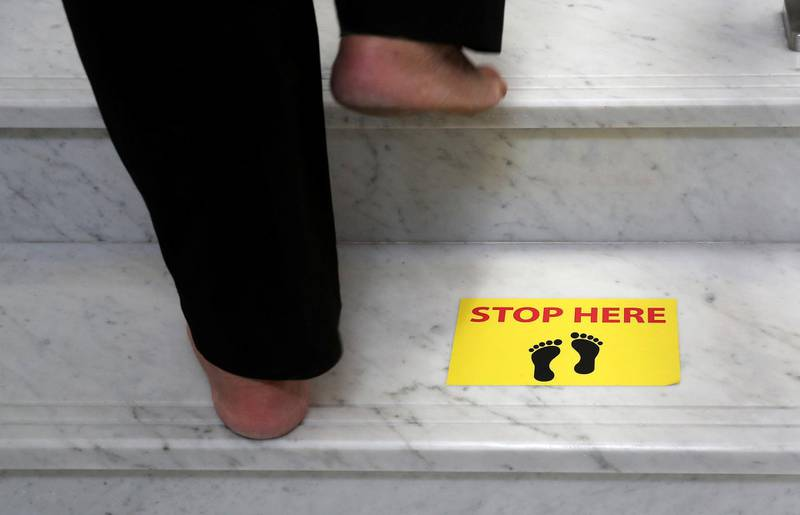 DUBAI, UNITED ARAB EMIRATES , June 30 – 2020 :- Safe distance marking stickers pasted on the floor at the Gurunanak Darbar in Jebel Ali in Dubai. Places of worship opening up tomorrow in the UAE. (Pawan Singh / The National) For News. Story by Ramola