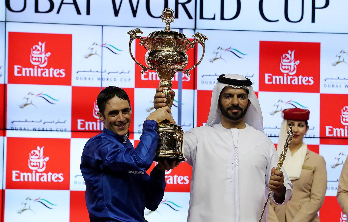 DUBAI , UNITED ARAB EMIRATES , MARCH 31  – 2018 :- Christophe Soumillon  with the Dubai World Cup trophy. Thunder Show (IRE) ridden by Christophe Soumillon  ( no 10  ) won the 9th horse race Dubai World Cup 2000m dirt during the Dubai World Cup held at Meydan Racecourse in Dubai. Also seen in the photo Trainer Saeed Bin Suroor on the right . ( Pawan Singh / The National ) For News/Sports. Story by Amith