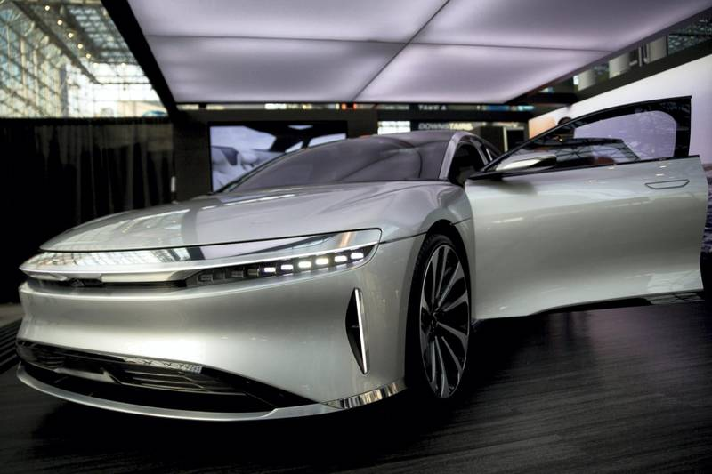 A Lucid Motors Inc. branded Air vehicle sits on display during the 2017 New York International Auto Show (NYIAS) in New York, U.S., on Wednesday, April 12, 2017. The New York International Auto Show, North America's first and largest-attended auto show dating back to 1900, showcases an incredible collection of cutting-edge design and extraordinary innovation. Photographer: Andrew Harrer/Bloomberg