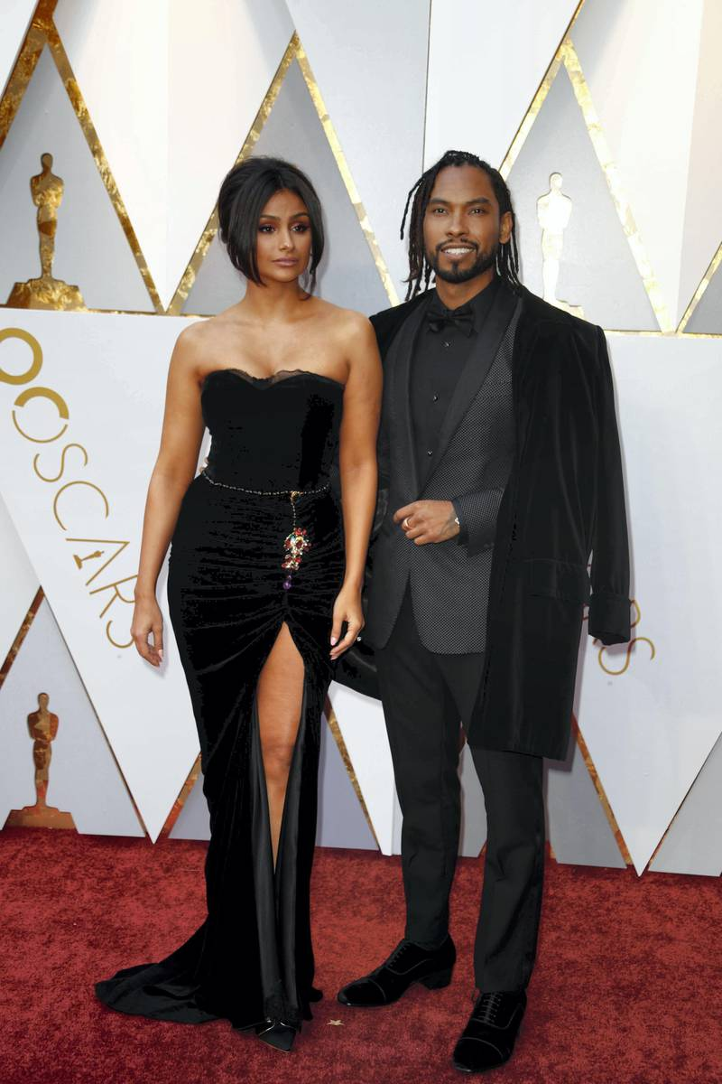 epa06580364 Miguel (R) and Nazanin Mandi arrive for the 90th annual Academy Awards ceremony at the Dolby Theatre in Hollywood, California, USA, 04 March 2018. The Oscars are presented for outstanding individual or collective efforts in 24 categories in filmmaking.  EPA-EFE/MIKE NELSON *** Local Caption *** 54173562