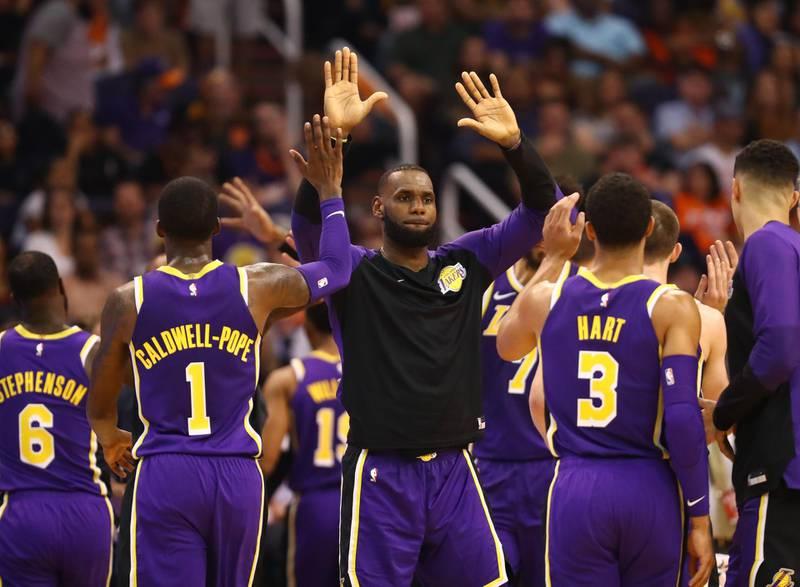 Oct 24, 2018; Phoenix, AZ, USA; Los Angeles Lakers forward Lebron James (center) celebrates with teammates against the Phoenix Suns in the second half at Talking Stick Resort Arena. Mandatory Credit: Mark J. Rebilas-USA TODAY Sports