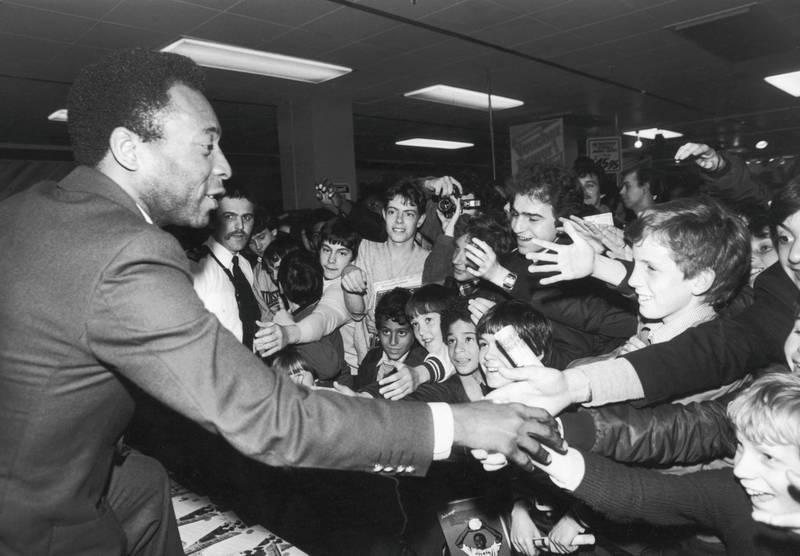 Brazilian footballer Pele greeting fans in the Oxford Street Debenhams store in London, 30th April 1981. (Photo by Ian Tyas/Keystone/Getty Images)