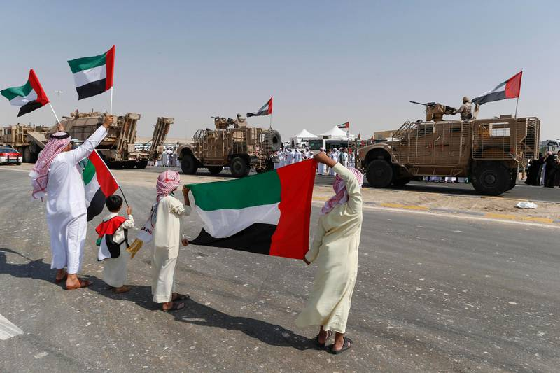 ABU DHABI, UNITED ARAB EMIRATES, 07 NOVEMBER 2015. Emirati Nationals celebrate the first return of soldiers from their campaign in Yemen at the entrance to Zayed Military City on the Sweihan road. (Photo: Antonie Robertson/The National) Journalist: Nasser Al Remeithi. Section: National. *** Local Caption ***  AR_0711_Soldiers_Return-07.JPG
