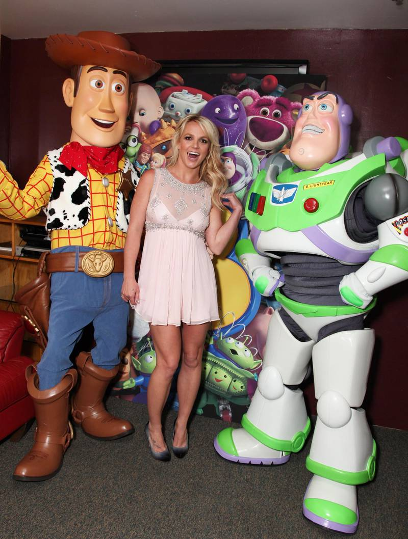 Mandatory Credit: Photo by Eric Charbonneau/Shutterstock (4377363cb) HOLLYWOOD, CA - JUNE 13: **EXCLUSIVE** Woody, Britney Spears and Buzz Lightyear at the World Premiere of Disney/Pixar's 'Toy Story 3' on June 13, 2010 at the El Capitan Theatre in Hollywood, California.  World Premiere of Disney/Pixar's 'Toy Story 3' Hollywood Los Angeles, America.
