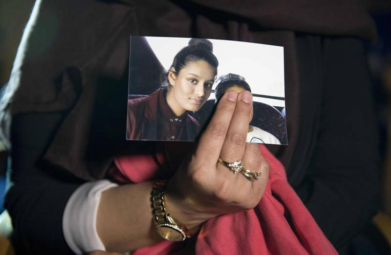 (FILES) In this file photo taken on February 22, 2015 Renu Begum, eldest sister of missing British girl Shamima Begum, holds a picture of her sister while being interviewed by the media in central London. A British teenager who fled to join the Islamic State group in Syria is living in a refugee camp and wants to return home, The Times reported on February 14, 2019. Shamima Begum, now 19, expressed no regrets about fleeing her London life four years ago but said that two of her children had died and, pregnant with her third, she wanted to return. / AFP / POOL / POOL / LAURA LEAN