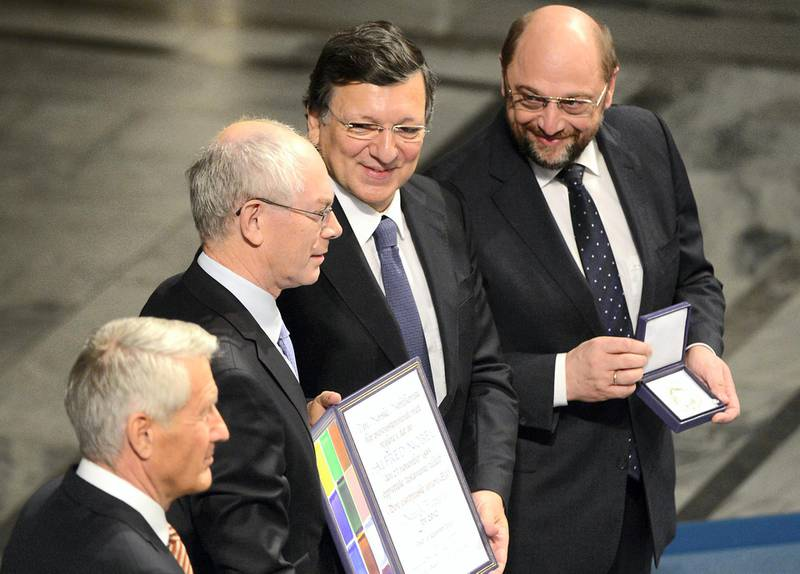 (LtoR) Chair of the Norwegian Nobel Committee Torbjorn Jagland applauds European Union (EU) President  Herman Van Rompuy, President of the European Commission Jose Manuel Barroso and President of the European Parliament Martin Schulz who pose after receiving the Nobel Peace Prize during the Nobel Peace Prize awarding ceremony at the City Hall in Oslo on December 10, 2012. The EU collects this year's prestigious Nobel Peace Prize, with the bloc battered and divided by a three-year economic crisis threatening the continent's social stability. AFP PHOTO / JOHN MACDOUGALL / AFP PHOTO / JOHN MACDOUGALL