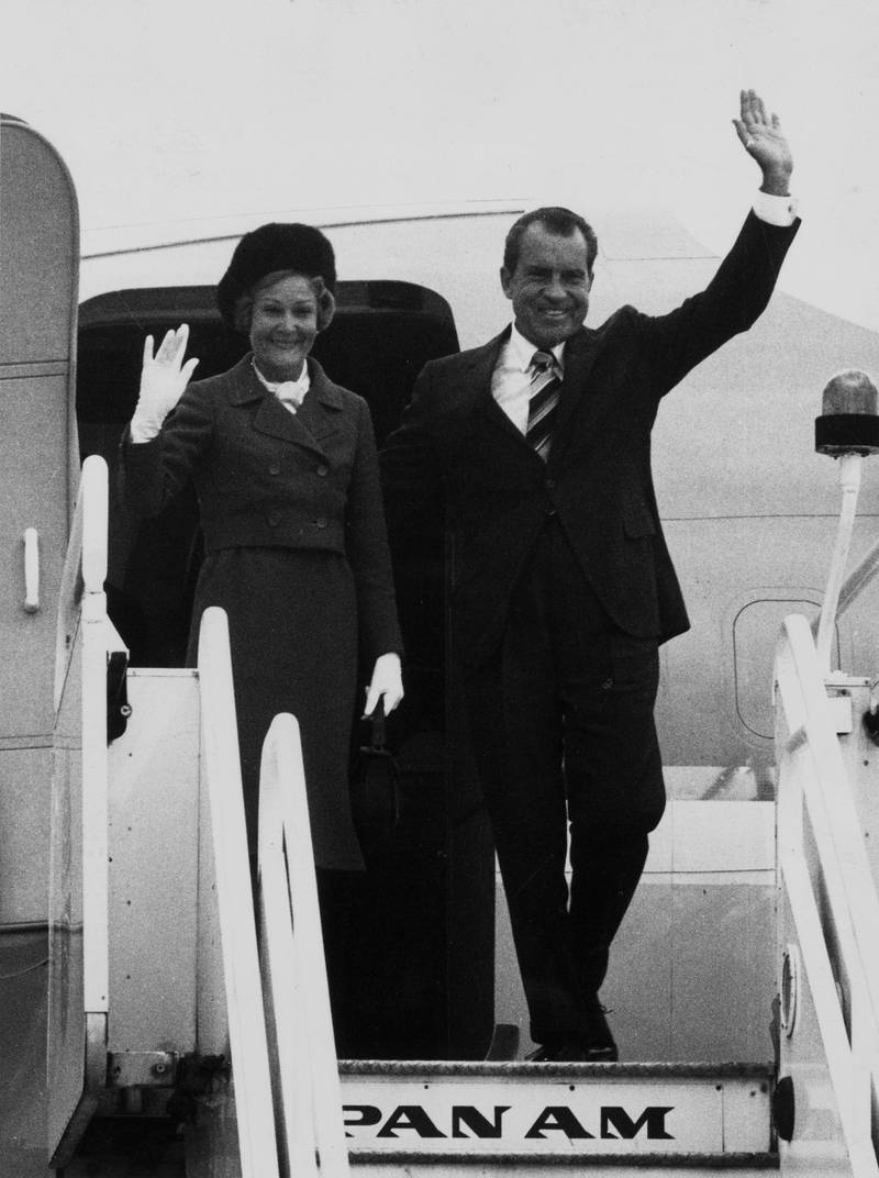 30th October 1970:  American President Richard Nixon and his wife Pat wave as they step off the Air Force One presidential aircraft after landing at Heathrow Airport, London, for a one-day visit to Britain.  (Photo by Evening Standard/Getty Images)