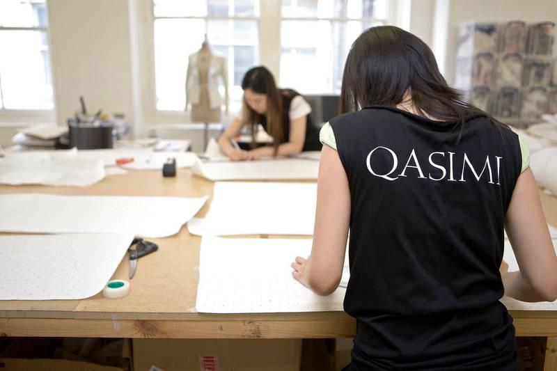 London, August 14 2008. Interns at fashion label Qasimi cut patterns at the company's East London studio. Qasimi is run by Elliott Frieze and Khalid Alqasimi. (Matt Crossick)