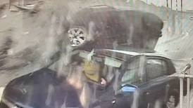 Dramatic moment driver flips his car and slams into  toll booth