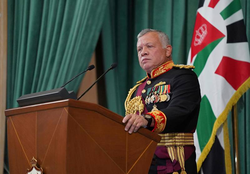 """FILE - In this Dec. 10, 2020  photo released by the Royal Hashemite Court, Jordan's King Abdullah II gives a speech during the inauguration of the 19th Parliament's non-ordinary session, in Amman Jordan.  Jordan's army chief of staff says the half-brother of King Abdullah II was asked to """"stop some movements and activities that are being used to target Jordan's security and stability."""" The army chief of staff denied reports Saturday, April 3, 2021, that Prince Hamzah was arrested. He said an investigation is still ongoing and its results will be made public """"in a transparent and clear form.""""   (Yousef Allan/The Royal Hashemite Court via AP, File)"""