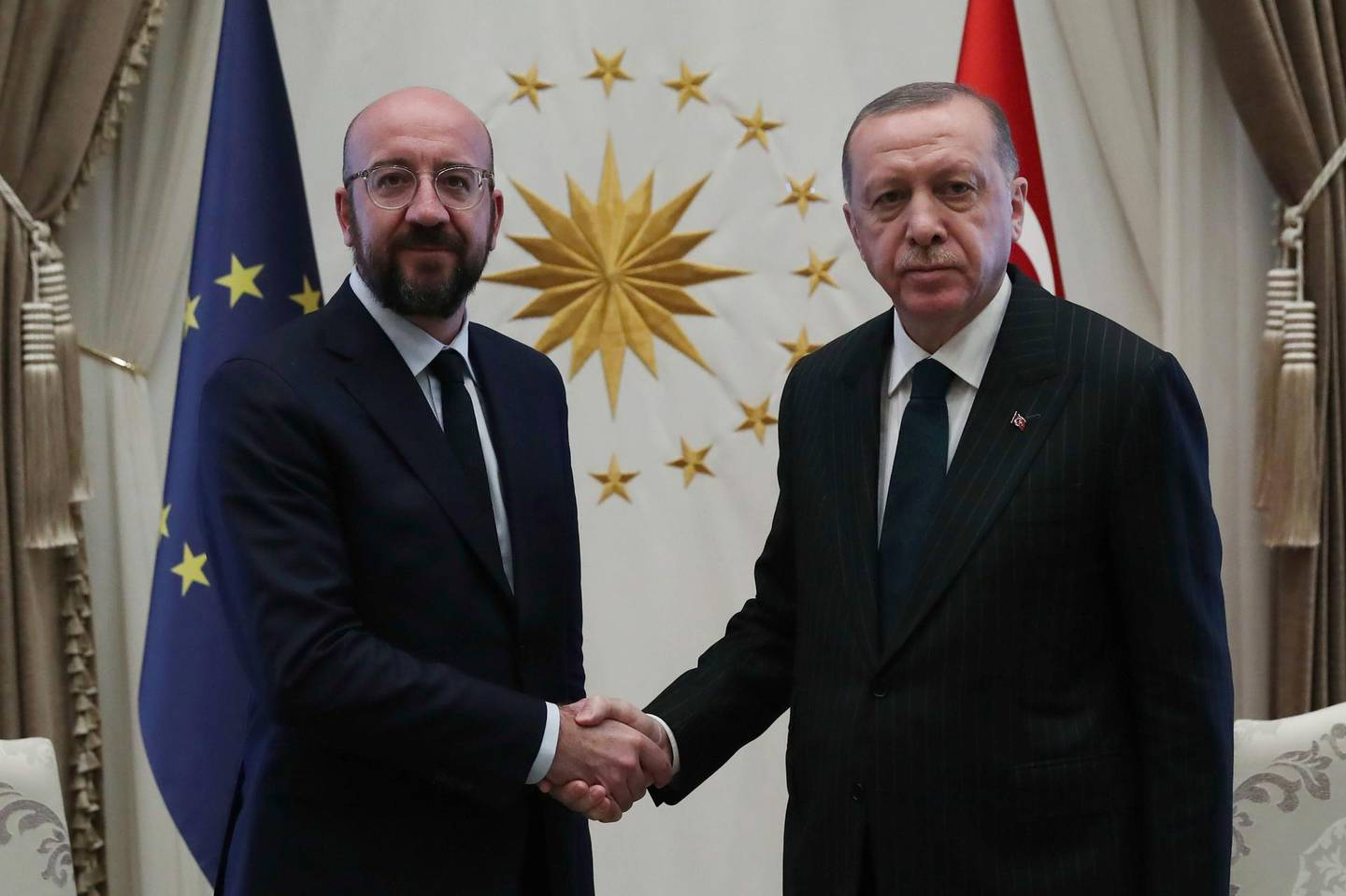 """A handout picture taken and released by the Turkish presidential press office shows Turkey's President Recep Tayyip Erdogan (R) shaking hands with European Council's President Charles Michel (L) at the Presidential Complex in Ankara, on March 4, 2020. EU foreign policy chief Josep Borrell and Council President Charles Michel met with Erdogan and other top officials in Ankara on Wednesday, promising an additional 170 million euros ($189 million) in aid for vulnerable groups in Syria.  - RESTRICTED TO EDITORIAL USE - MANDATORY CREDIT """"AFP PHOTO / TURKISH PRESIDENTIAL PRESS SERVICE / MURAT CETINMUHURDAR """" - NO MARKETING NO ADVERTISING CAMPAIGNS - DISTRIBUTED AS A SERVICE TO CLIENTS  / AFP / TURKISH PRESIDENTIAL PRESS SERVICE / Murat CETINMUHURDAR / RESTRICTED TO EDITORIAL USE - MANDATORY CREDIT """"AFP PHOTO / TURKISH PRESIDENTIAL PRESS SERVICE / MURAT CETINMUHURDAR """" - NO MARKETING NO ADVERTISING CAMPAIGNS - DISTRIBUTED AS A SERVICE TO CLIENTS"""
