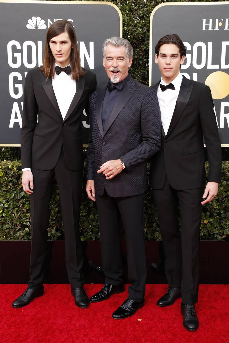 epa08105539 Pierce Brosnan, and his sons Paris Brosnan (R) and Dylan Brosnan (L) arrive for the 77th annual Golden Globe Awards ceremony at the Beverly Hilton Hotel, in Beverly Hills, California, USA, 05 January 2020.  EPA-EFE/NINA PROMMER