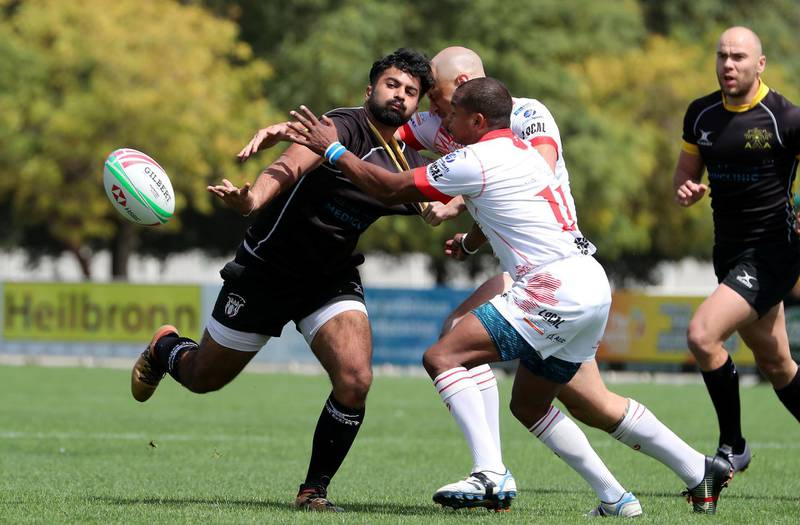 DUBAI , UNITED ARAB EMIRATES , March 29 – 2019 :- Ebrahim Doraee ( no 15 black ) from Al Ain Amblers in action during the UAE Conference final rugby match against Dubai Tigers at the Sevens Rugby Ground on Dubai- Al Ain road in Dubai.( Pawan Singh / The National ) For Sports/Online. Story by Paul