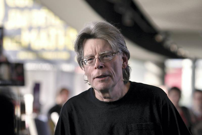 """American author Stephen King poses for photographers on November 13, 2013 in Paris, before a book signing event dedicated to the release of his new book """"Doctor Sleep"""", the sequel to his 1977 novel """"The Shining"""". The best-selling author has written over 50 novels and sold 350 million copies worldwide.   AFP PHOTO / KENZO TRIBOUILLARD (Photo by KENZO TRIBOUILLARD / AFP)"""