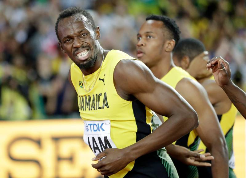 Jamaica's Usain Bolt grimaces after injuring himself during the men's 4x100m final at the World Athletics Championships in London Saturday, Aug. 12, 2017. (AP Photo/Matthias Schrader)