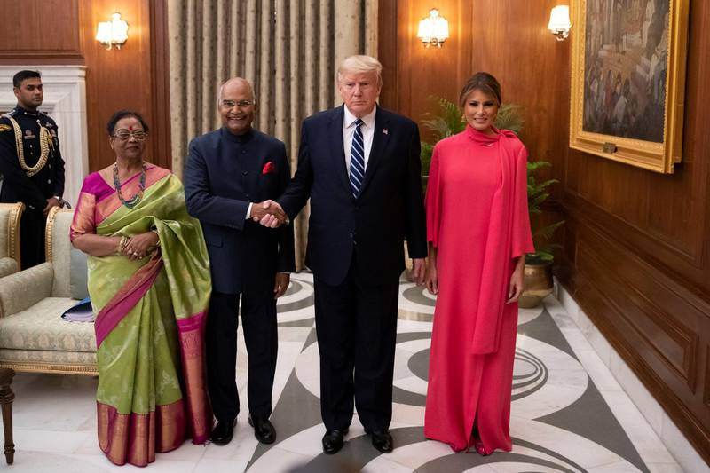 Indian President Ram Nath Kovind and his wife Savita Kovind stand with President Donald Trump and first lady Melania Trump as they arrive for a state banquet at Rashtrapati Bhavan, in New Delhi, India February 25, 2020.  Alex Brandon/PoolviaREUTERS