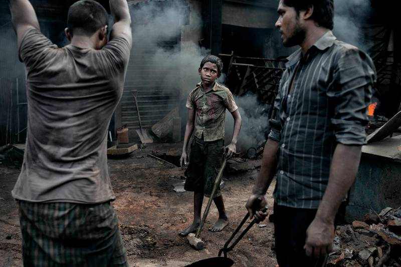 A child labourer in a shipyard working with adult workers, means missing out on a formal education Dhaka, Bangladesh June 17, 2015. The laborers work in the dockyard without proper safety measures and unsafe conditions. Mostly the Local Ships are built and repair in this place. Bangladesh has been ranked as one of the worst countries in the world for workers rights, according to the International Trade Union Confederations 2015 ITUC Global Rights Index.