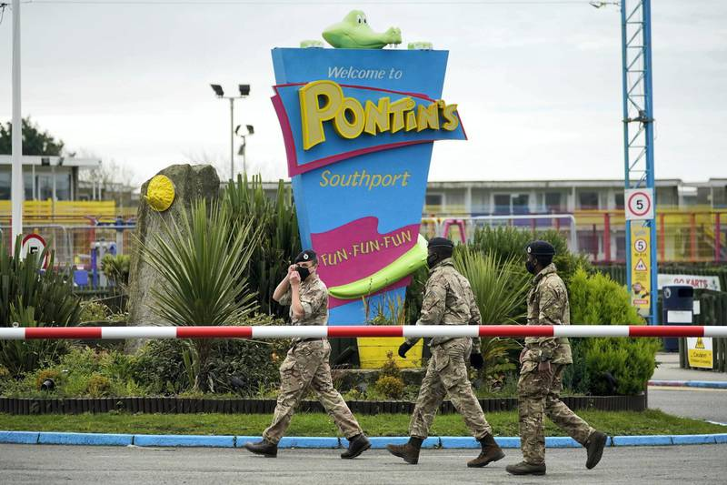 SOUTHPORT, ENGLAND - NOVEMBER 05:  Members of the military arrive at Pontins by Ainsdale Beach to set up a mass Covid-19 testing facility on November 5, 2020 in Southport, England. The UK government are piloting loop mediated isothermal amplification (LAMP) testing technology, offering all Liverpool residents quick-result tests to identify who has coronavirus and asking them to isolate. If this LAMP technology is successful it could lead to an end to lockdowns as a method to combat the COVID-19 Pandemic. (Photo by Christopher Furlong/Getty Images)
