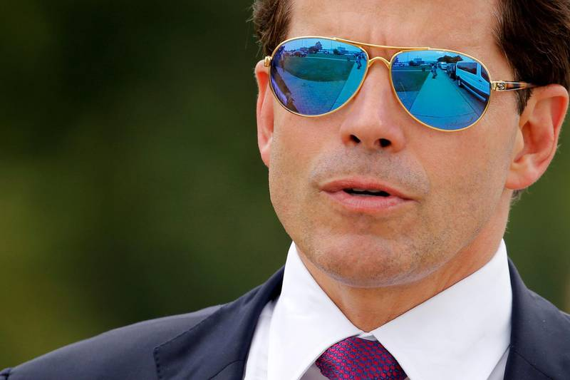 FILE PHOTO: White House Communications Director Anthony Scaramucci accompanies U.S. President Donald Trump for an event about his proposed U.S. government effort against the street gang Mara Salvatrucha, or MS-13, with a gathering of federal, state and local law enforcement officials in Brentwood, New York, U.S. July 28, 2017. REUTERS/Jonathan Ernst/File Photo