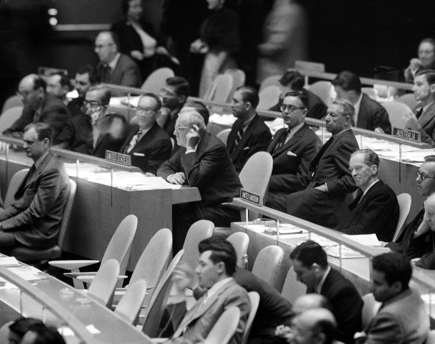 U.S. secretary of state John Foster Dulles, left and British Delegate Sir Pierson Dixon, right, sit on opposite side of the aisle at United Nations General Assembly meeting on Nov. 2, 1956 in New York, during voting on a resolution urging an immediate cease-fir in Egypt. They were also on opposite side in the voting. (AP Photo)