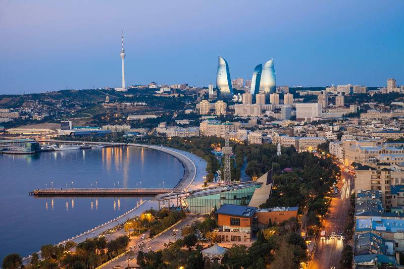Azerbaijan, Baku, View of city looking towards The Baku Business Center on the Bulvur - waterfront in the distance are  Flame Towers and TV tower. Getty Images