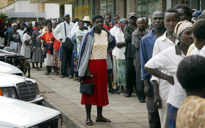 A queue for meali meal in Mutare, Zimbabwe. The poor and impoverished citizens wait patiently for their free food. (Photo by In Pictures Ltd./Corbis via Getty Images)