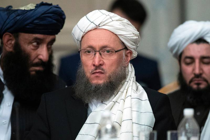 """Taliban official Abdul Salam Hanafi, center, attends the """"intra-Afghan"""" talks in Moscow, Russia, Wednesday, Feb. 6, 2019. Taliban official Abdul Salam Hanafi, speaking on the sidelines of a meeting in Moscow between the Taliban and other prominent Afghan figures, said that U.S. officials promised the pullout will begin this month. (AP Photo/Pavel Golovkin)"""