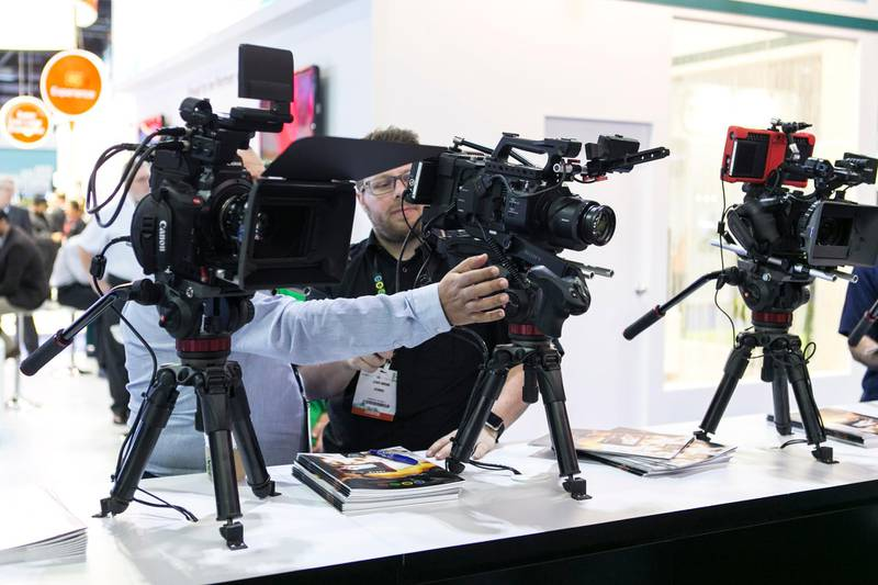 DUBAI, UNITED ARAB EMIRATES, MAR 8, 2016. People test Canon cameras at CABSAT, Middle East and Africa's largest broadcast, digital media and satellite event.Photo: Reem Mohammed / The National (Section: BZ NEWS) Job ID 38452 *** Local Caption ***  RM_20160308_CABSAT_02.JPG