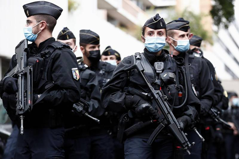 epa08696219 French police officers are deployed near the former Charlie Hebdo offices, in Rue Nicolas Appert in Paris, France, 25 September 2020, after four people have been wounded in knife attack. According to recent reports, one assailant has been arrested in the Bastille area.  EPA/IAN LANGSDON