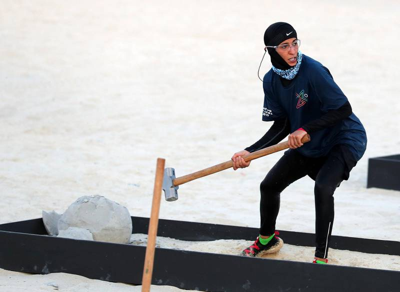 Dubai, United Arab Emirates - April 06, 2019: A member of the DEWA team takes part in the women's finals of the Gov Games 2019. Saturday the 6th of April 2019. Kite Beach, Dubai. Chris Whiteoak / The National