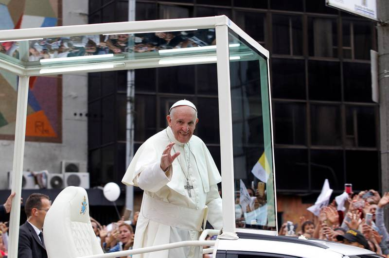 Pope Francis waves to the crowd from the popemobile after visiting an orphanage in Medellin, Colombia in his way to La Macarena stadium, September 9, 2017. REUTERS/Fredy Builes