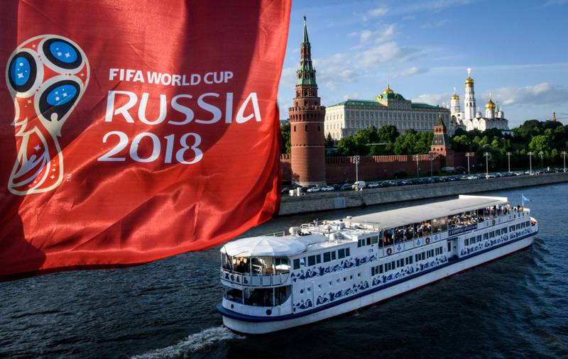 A photograph taken on May 30, 2018  shows the FIFA World Cup 2018 flag in front of the Kremlin in Moscow. The FIFA World Cup 2018 tournament kicks off on June 14, 2018. / AFP / Mladen ANTONOV