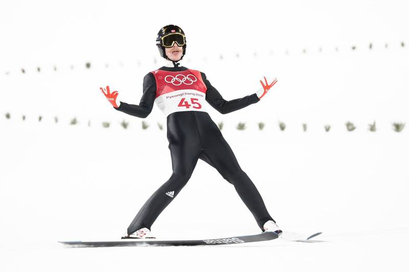 TOPSHOT - Norway's Robert Johansson reacts after competing in the men's normal hill individual ski jumping event during the Pyeongchang 2018 Winter Olympic Games on February 10, 2018, in Pyeongchang. / AFP PHOTO / Odd ANDERSEN