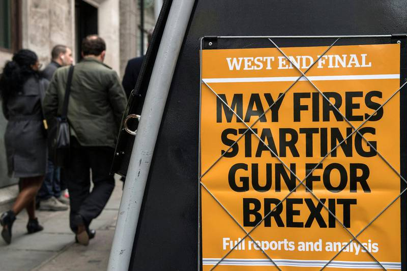 """A newspaper stand shows an advert for today's Evening Standard newspaper, leading with the story relating to British Prime Minister Theresa May's triggering of Article 50 of the Lisbon Treaty to begin the process of Britain's withdrawal from the European Union (EU), in London on March 29, 2017. - Britain launched the process to leave the European Union Wednesday, saying there was """"no turning back"""" from the historic move that has split the country and thrown the bloc's future into question. (Photo by CHRIS J RATCLIFFE / AFP)"""