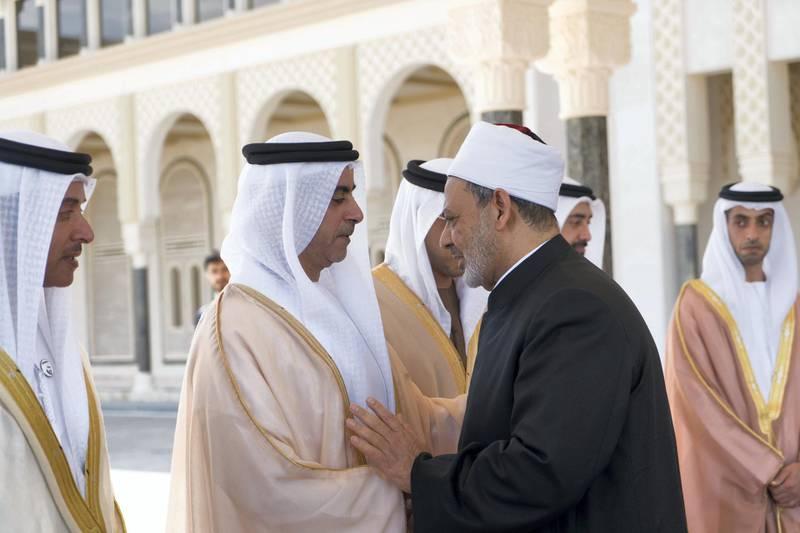 ABU DHABI, UNITED ARAB EMIRATES - February 05, 2019: Day three of the UAE Papal visit - HH Lt General Sheikh Saif bin Zayed Al Nahyan, UAE Deputy Prime Minister and Minister of Interior (2ns L), bids farewell to His Eminence Dr Ahmad Al Tayyeb, Grand Imam of the Al Azhar Al Sharif (R), at the Presidential Airport.    ( Rashed Al Mansoori / Ministry of Presidential Affairs ) ---