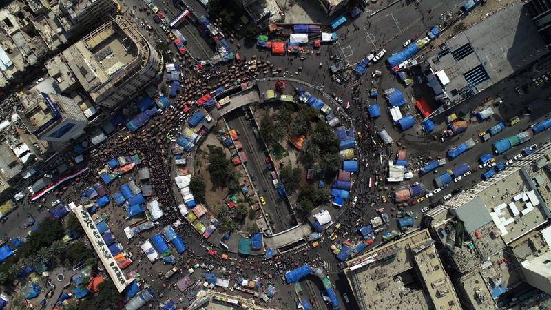 epa08262880 An aerial picture taken by a drone shows Iraqi protesters at the Al-Tahrir square in central Baghdad, Iraq, 01 March 2020. Thousands of Iraqis continue their protests in Baghdad and southern Iraqi cities against the appointment of Mohammed Tawfiq Allawi as prime minister-designate, while the Iraqi parliament failed to give confidence again on 01 March 2020 to the cabinet proposed by Allawi because of a lack of quorum.  EPA/MURTAJA LATEEF