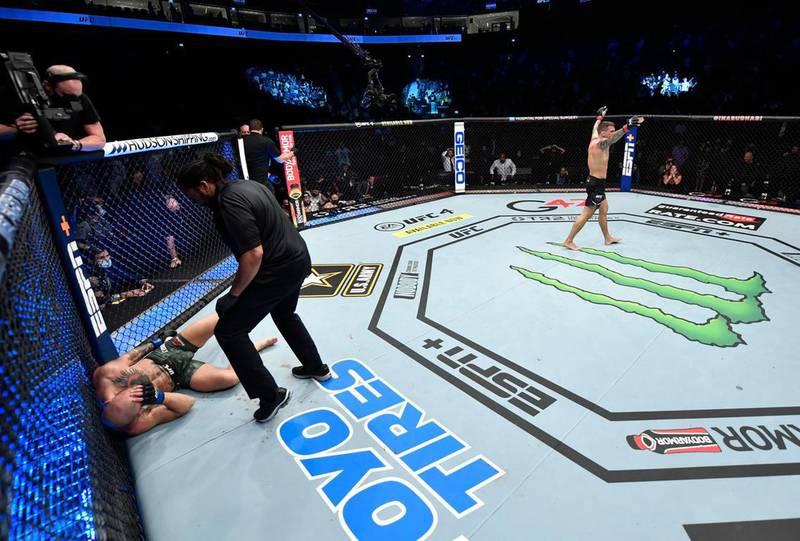 Dustin Poirier celebrates after beating Conor McGregor. Jeff Bottari/Zuffa LLC