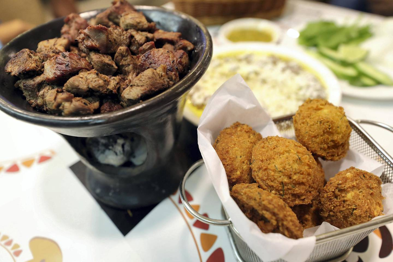 Abu Dhabi, United Arab Emirates - July 24, 2019: Shaia, a lamb dish and falafel. Al Mufraka restaurant, one of Abu DhabiÕs small number of Sudanese restaurants. Wednesday the 24th of July 2019. Abu Dhabi. Chris Whiteoak / The National