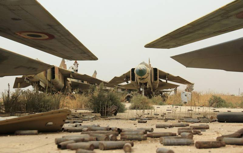A general view shows former Syrian army MiG-23 fighter jets at the Abu Duhur military airport, the last regime-held military base in northwestern Idlib province, after Al-Qaeda's Syrian affiliate and its allies seized the base on September 9, 2015 in the latest setback for President Bashar al-Assad's forces. Al-Nusra Front and a coalition of mostly Islamist groups captured the military airport after a siege that lasted two years, the Syrian Observatory for Human Rights monitor said. AFP PHOTO / OMAR HAJ KADOUR (Photo by OMAR HAJ KADOUR / AFP)