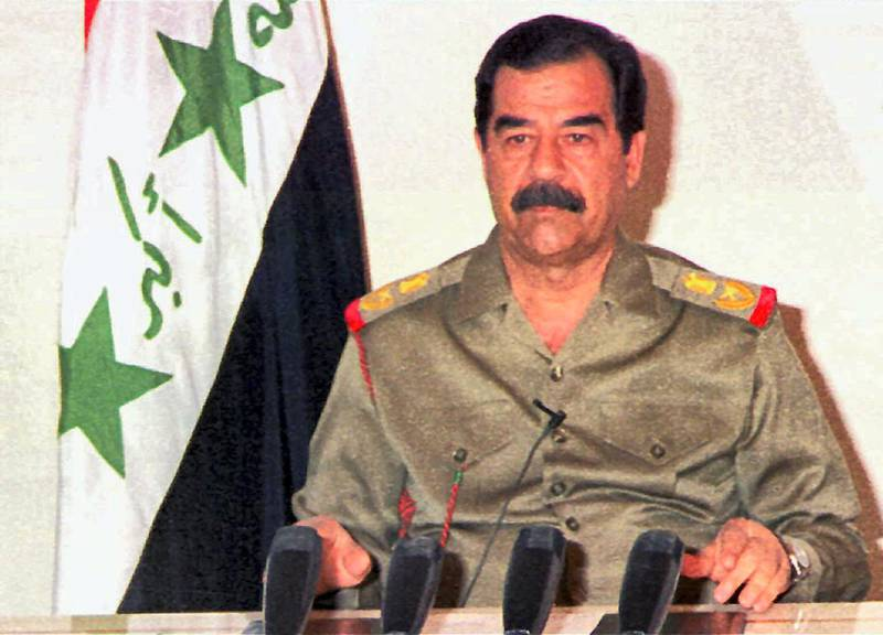 """Iraqi President Saddam Hussein gives a TV address 03 September following the US airstrikes in southern Iraq. Saddam said that anti-aircraft guns had knocked down many of the missiles, although an Iraqi official told AFP the attack caused """"many civilian casualties."""" AFP PHOTO Karim SAHIB / AFP PHOTO / KARIM SAHIB"""