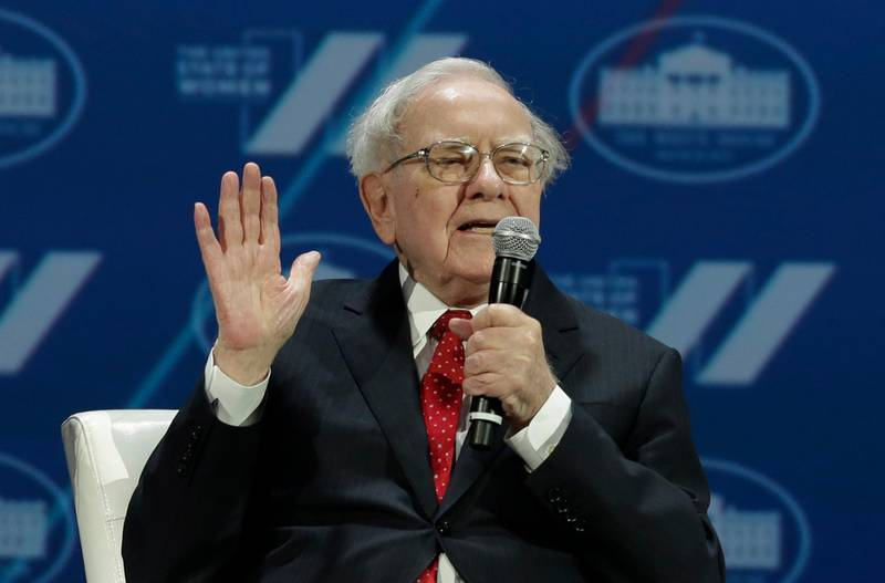 """(FILES) This file photo taken on June 14, 2016 shows Investor Warren Buffett speaking during the """"United State of Women Summit"""" at the Washington Convention Center in Washington, DC. Three titans of American business announced Tuesday they are joining forces to tackle one of the most enduring problems in American society: quality affordable healthcare. Billionaire Warren Buffett's Berkshire Hathaway and Jeff Bezos' retail behemoth Amazon will link with financial giant JP Morgan to create a nonprofit healthcare plan to """"provide US employees and their families with simplified, high-quality and transparent healthcare at a reasonable cost,"""" the companies said.  / AFP PHOTO / YURI GRIPAS"""