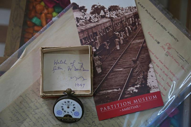 This July, 21, 2017 photograph, shows a pocket watch of Indian man Pandit Devi Dass, who was killed in mob violence in Pakistan which was later donated by his son to the Partition Museum, in New Delhi, India. A new museum on the Partition of the Indian subcontinent opens this week, in the north Indian border city of Amritsar, as the two South Asian giants celebrate seven decades as independent nations. (AP Photo/Altaf Qadri)