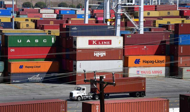 (FILES) In this file photo shipping containers are stacked high at the Port of Los Angeles, California on April 19, 2021. The US trade deficit dialed back in April, as exports rose and imports fell, according to government data released on June 8, 2021. The $68.9 billion deficit in goods and services recorded by the Commerce Department was slightly larger than expected and came as the world's largest economy was bouncing back rapidly from the Covid-19 pandemic, aided by nationwide vaccination campaigns.  / AFP / Frederic J. BROWN