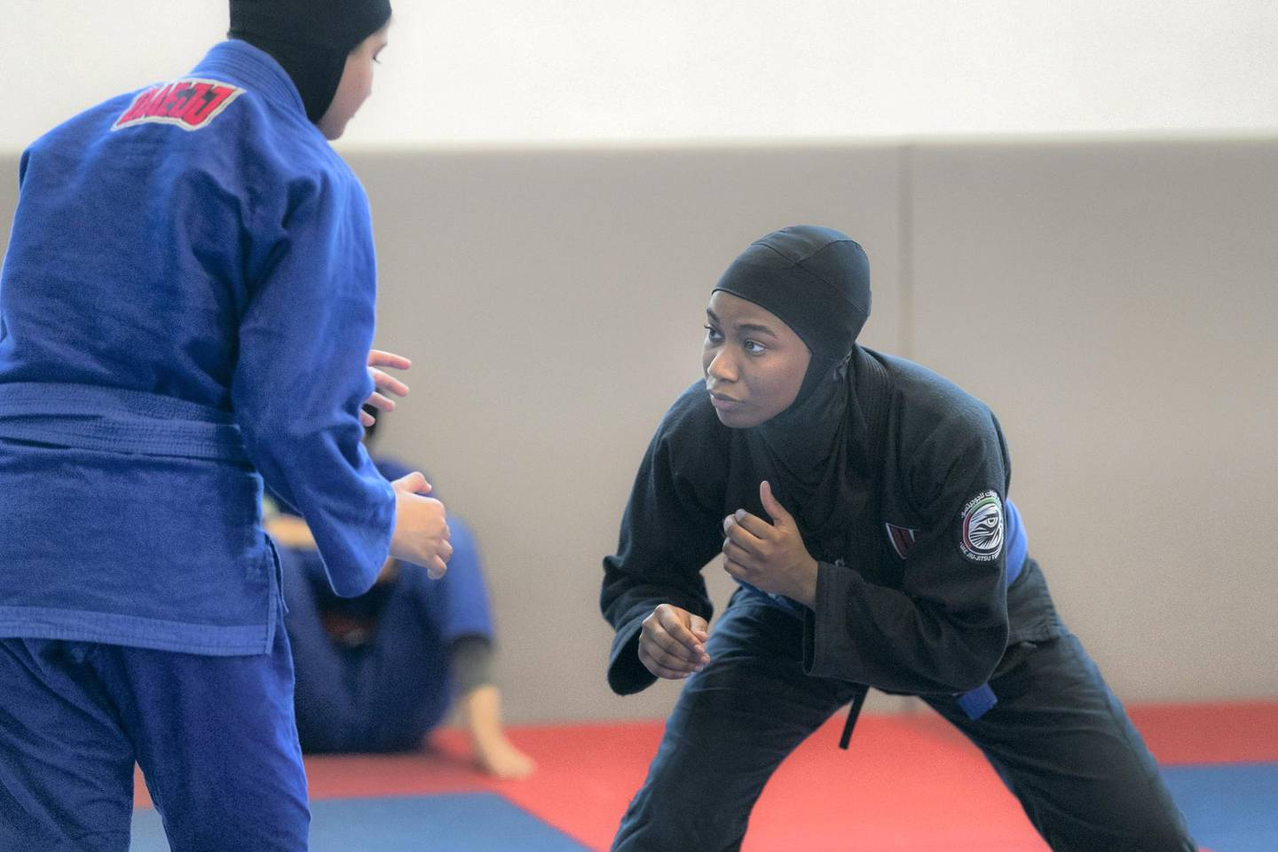 ABU DHABI, UNITED ARAB EMIRATES - AUGUST 14, 2018. Hessa Al Shamsi, in black, of the UAE Jiu Jitsu national team, trains for the Asian Games 2018.(Photo by Reem Mohammed/The National)Reporter: AMITH PASSATHSection:  SP