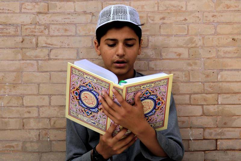 epa08385093 A Pakistani Muslim boy reads verses from the holy Koran at a Mosque during the Muslim holy month of Ramadan amid lockdown of the Khyber Pakhtunkhwa  province due to the ongoing coronavirus COVID-19 disease pandemic, in Peshawar, Pakistan, 26 April 2020. Muslims around the world celebrate the holy month of Ramadan, by praying during the night time and abstaining from eating, drinking, and sexual acts during the period between sunrise and sunset. Ramadan is the ninth month in the Islamic calendar and it is believed that the revelation of the first verse in Koran was during its last 10 nights.  EPA/BILAWAL ARBAB