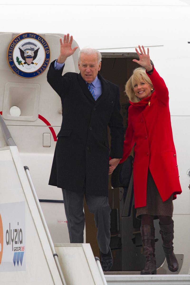 epa03567067 US Vice President Joe Biden (L) and his wife Jill Biden (R) exit Air Force Two as they land at Orly airport as part of Joe Biden's first official visit to Paris, France, 03 February 2013.  EPA/JACQUES BRINON / POOL MAXPPP OUT