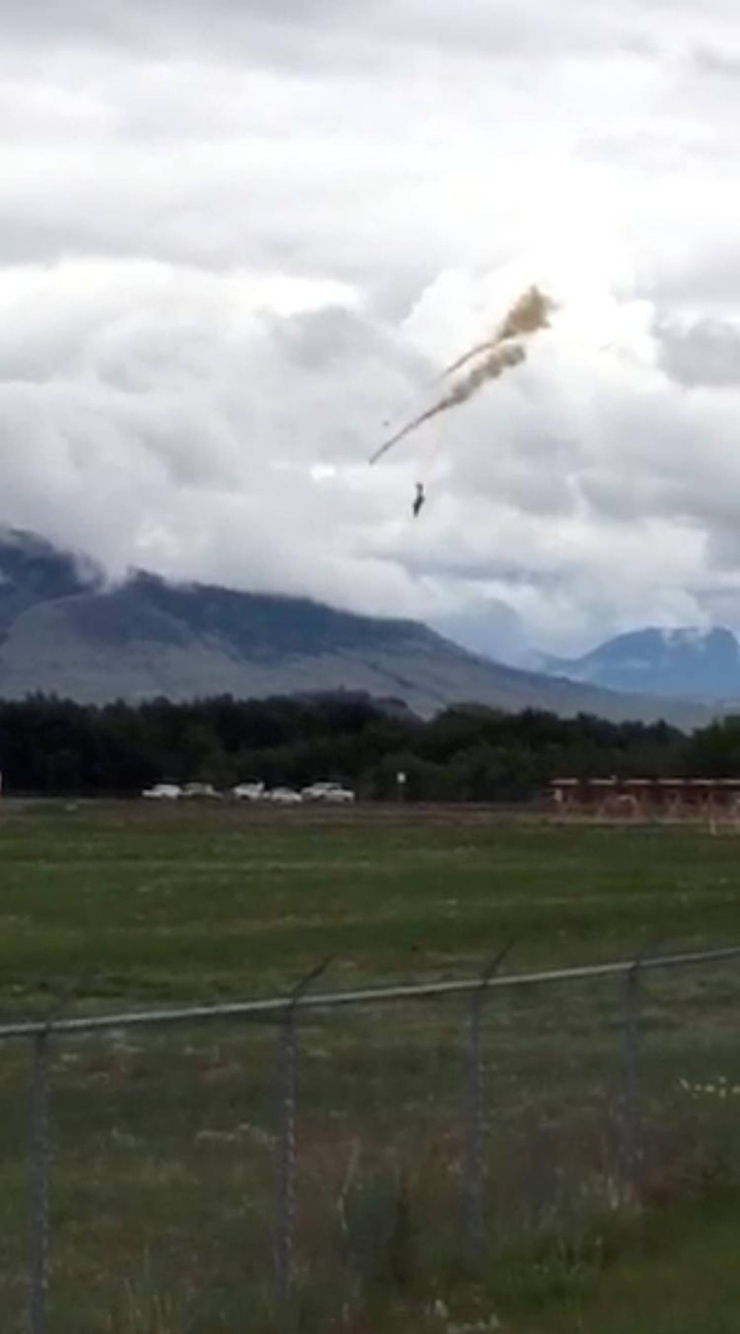 A plane of the Canadian Air Force's Snowbirds aerobatic demonstration team is seen prior crashing in Kamloops, British Columbia, Canada May 17, 2020, in this still image obtained from a social media video. Shannon Forrest/via REUTERS THIS IMAGE HAS BEEN SUPPLIED BY A THIRD PARTY. MANDATORY CREDIT. NO RESALES. NO ARCHIVES.